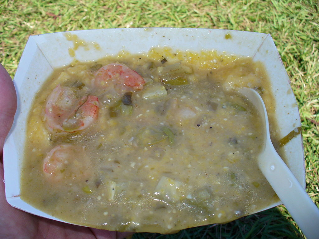 Mirliton stew over grits at the Bywater Mirliton Festival. (Photo via Flickr user Infrogmation New Orleans)