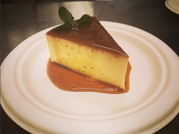 Congreso Cubano's slice of Flan de Leche, a classic baked Cuban cream custard, garnished with caramel and locally-grown mint (photo courtesy of Congreso Cubano)