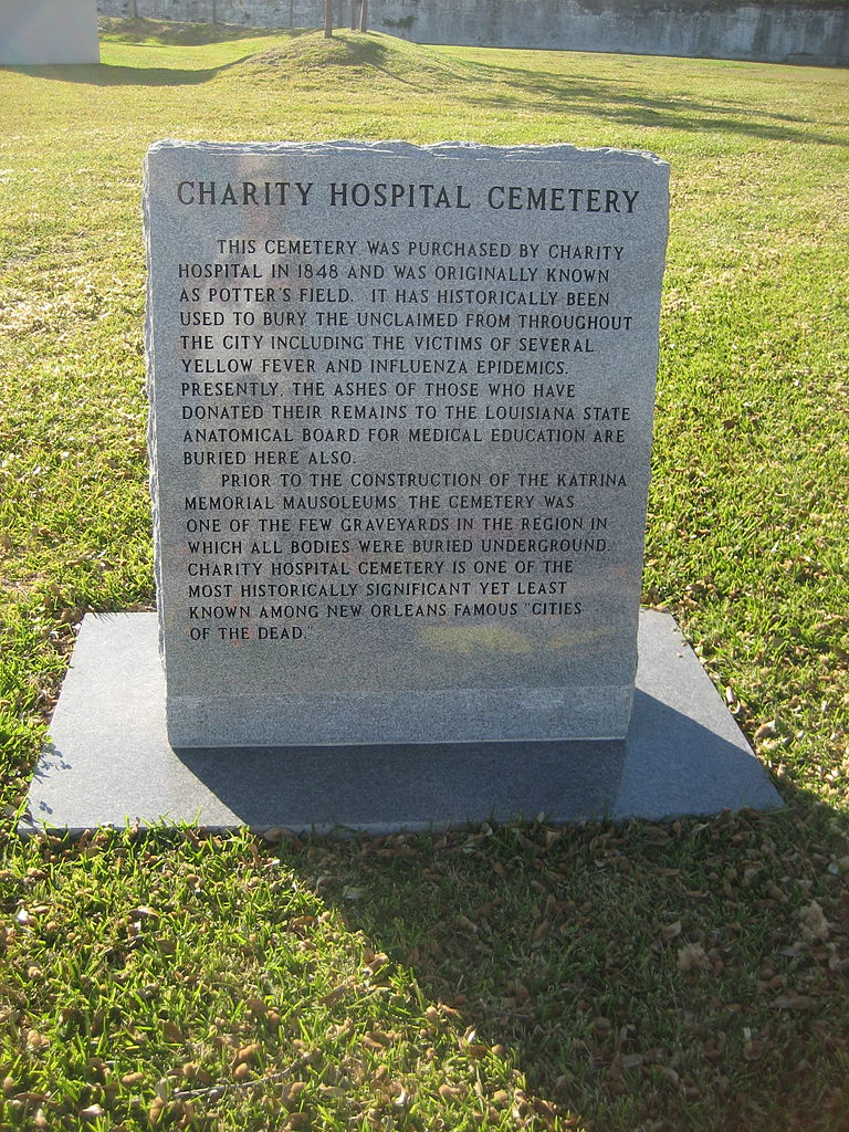 "Historic stone marker in Charity Hospital Cemetery. (Courtesy Carlos ""Froggy"" May)"