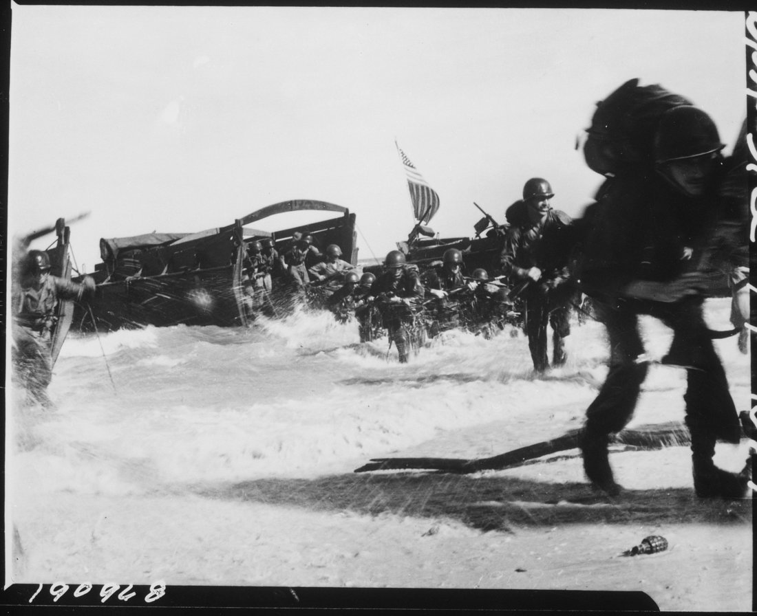American troops of the 163rd Infantry Regiment, hit the beach from Higgins boats during the invasion of Wadke Island, Dutch New Guinea. (US Army photo, photographer unknown)