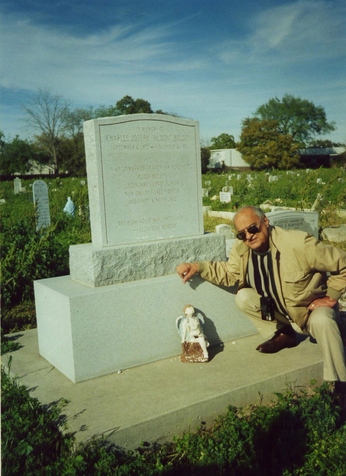 Bolden biographer Don Marquis, next to Buddy Bolden's marker in Holt Cemetery, 1996 (Photo via Infrogmation on Flickr)