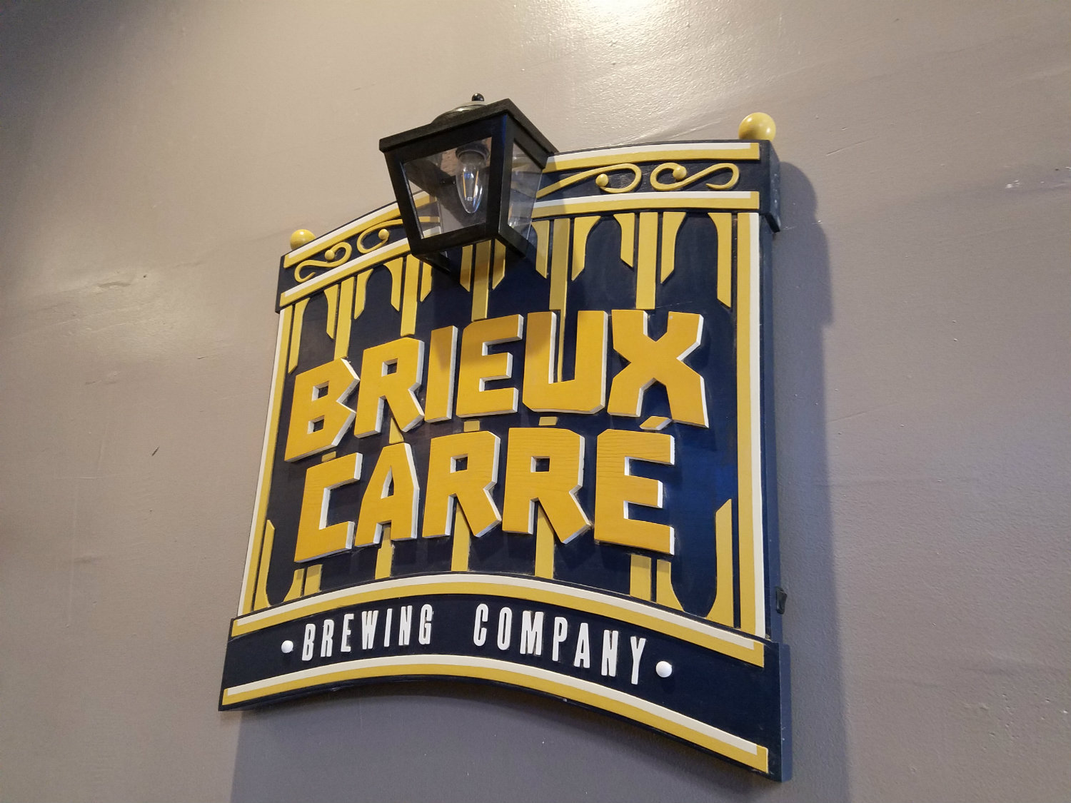 Brieux Carre sign-small