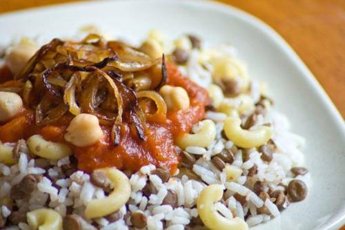 Kushari, the national dish of Egypt, features rice, brown lentils, pasta, chickpeas, spicy tomato pepper sauce and fried shallots. Image courtesy of Carmo Cafe.