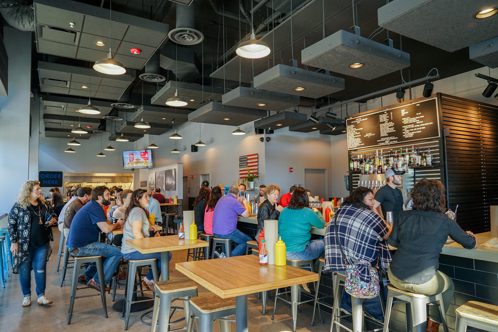 The inside of the downtown Company Burger is similar to its uptown counterpart on Freret Street, except this one is a little bigger -- both in the kitchen, number of seats, and now with a full service bar. It's open all day seven days a week for lunch and dinner, and is a popular spot to tailgate when there's a Saints game in the nearby Superdome.