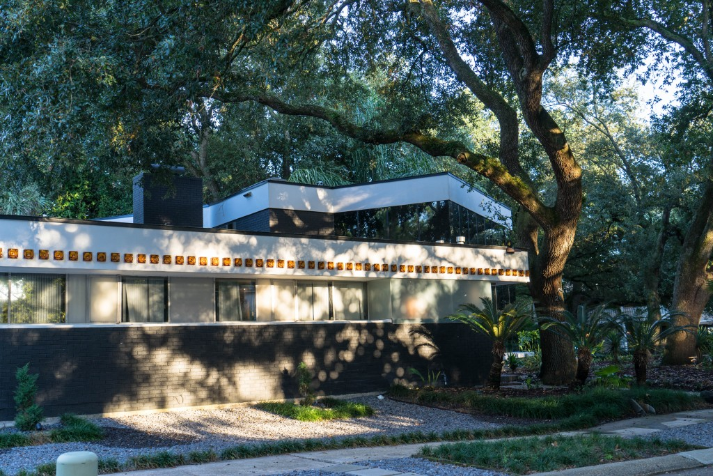 """The Albert Ledner designed """"Ashtray House"""" (fitted with glass ashtrays as a decorative border on the facade) is on the quaint Park Island just north of Harrison Avenue in Bayou St. John"""