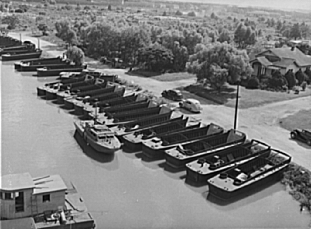 Higgins Boats lined up on the New Basin Canal, 1943. (John Vachon photo in the public domain)