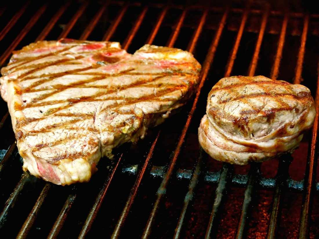 (Steak on the grill at Charlie's Steak House. Photo credit: Christopher Garland.)