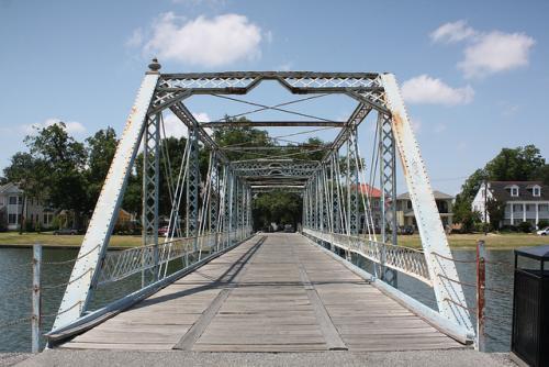 Historic Magnolia Bridge over Bayou St. John in New Orleans, Louisiana. Also known as the Cabrini Bridge. Image courtesy cmh2315fl, via Flickr.