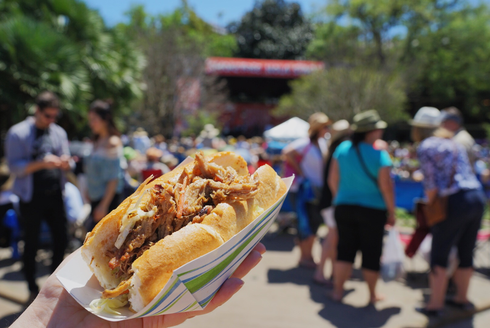 The quintessential New Orleans festival accessory: A Walker's/Love At First Bite Cochon de Lait Po-boy! (Photo: Paul Broussard)