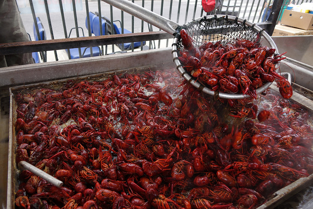 The Esplanade in the Shade stage at the Louisiana State Museum at the Old U.S. Mint is the place to go at French Quarter Fest for boiled crawfish, expertly boiled from Rouses Supermarkets.