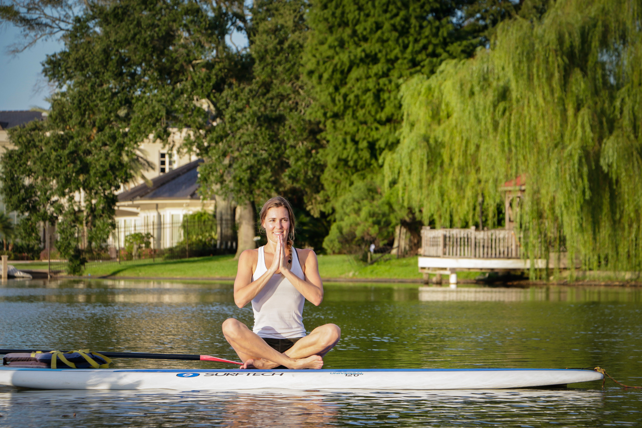 Each SUP yoga class begins with a tranquil warm-up paddle. (Photo: Rebecca Ratliff)