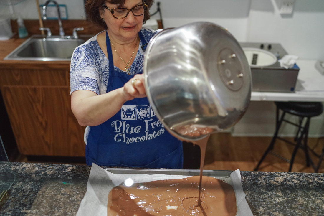 Blue Frog Chocolates owner Ann Streiffer (pictured) and her staff are constantly making chocolate to pour into shaped molds representing any number of forms: frogs, dinosaurs, crawfish, oysters (with candied pearls), ballerinas, gavels...chocolates for any occasion.