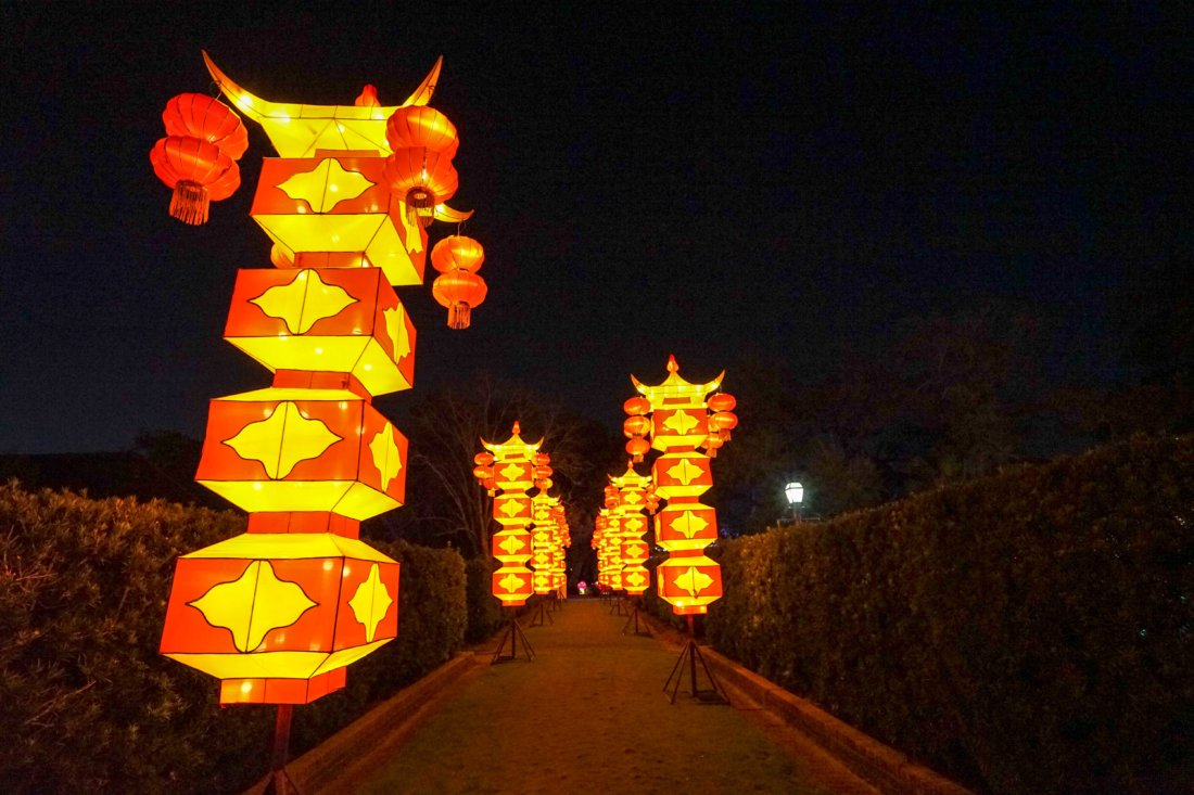 Chinese Lantern Columns illuminate the path.