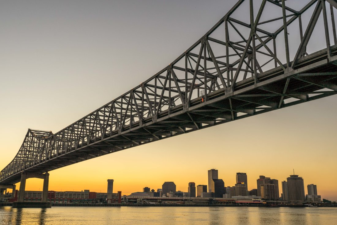 Sunset along the Mississippi River can be pretty magical, particularly when viewed from beneath the Greater New Orleans and Crescent City Connection bridges from Algiers. Accessible from the levee trail that runs along the river, if you're on Algiers Point near the ferry terminal, it's worth the several block walk along the levee to stand beneath these magnificent structures. They're the perfect framing device for the NOLA downtown skyline when the sun goes down (or at any hour.)