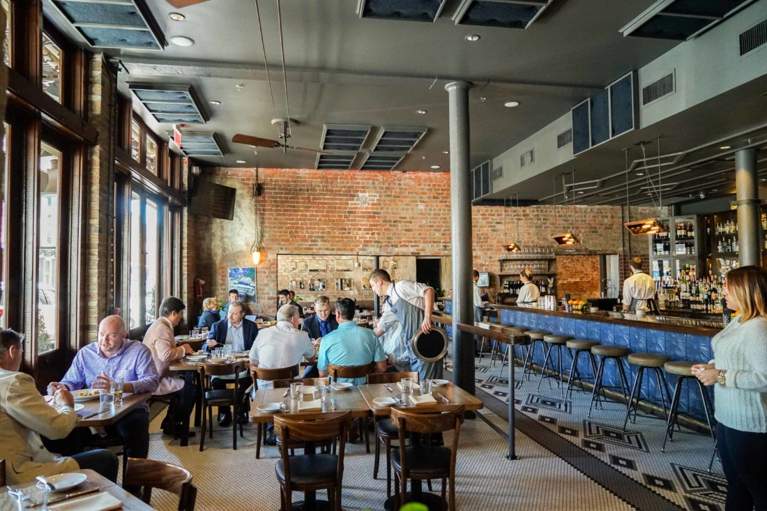 The design of Compere Lapin emphasizes the rustic warmth of the building's warehouse roots. It's a fun dining room to people watch, have lunch or dinner or just drinks in, open to the lobby of the Old No. 77 Hotel.