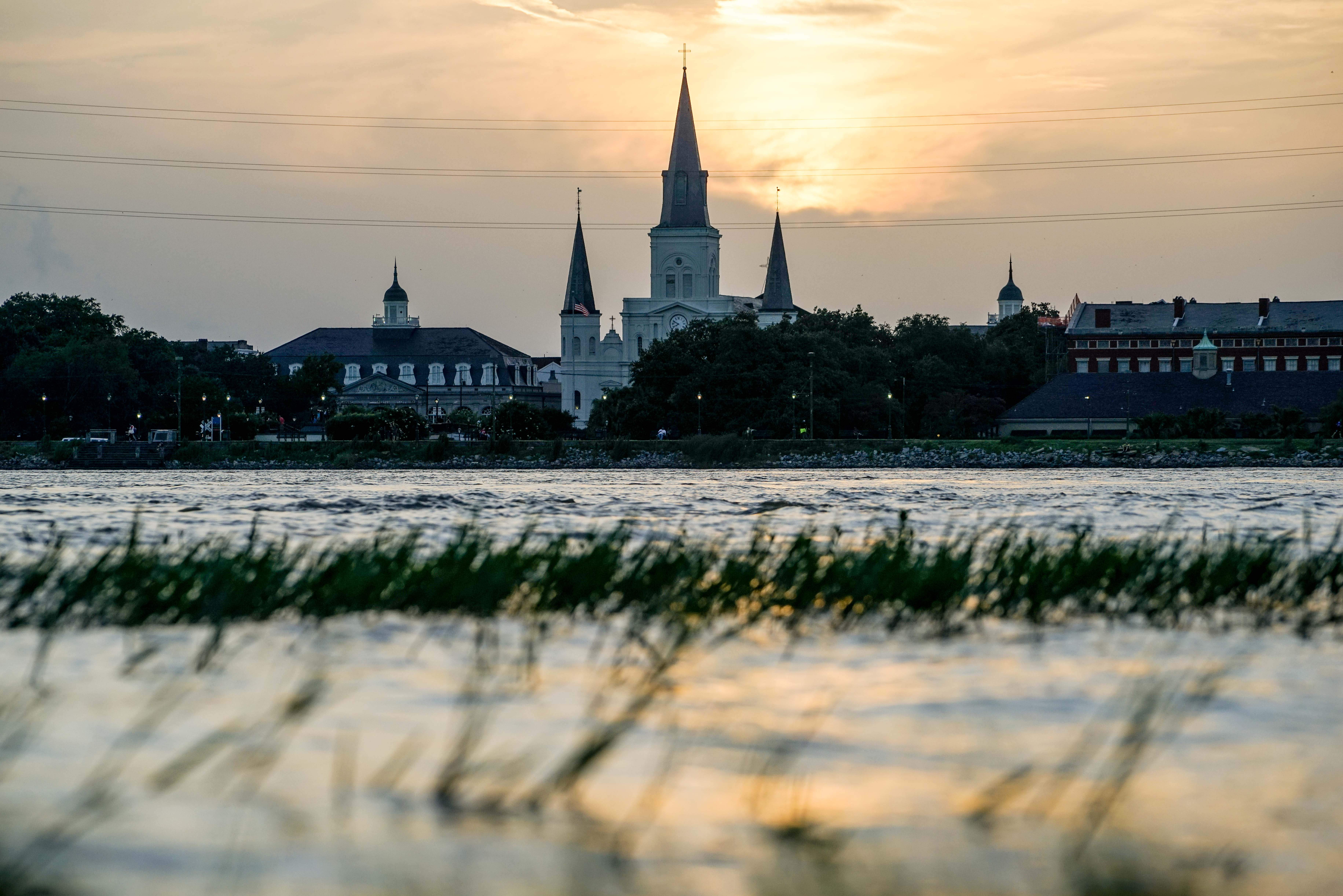 Experience the sunset behind Jackson Square with expansive views of the city from Algiers Point, steps from the ferry landing.