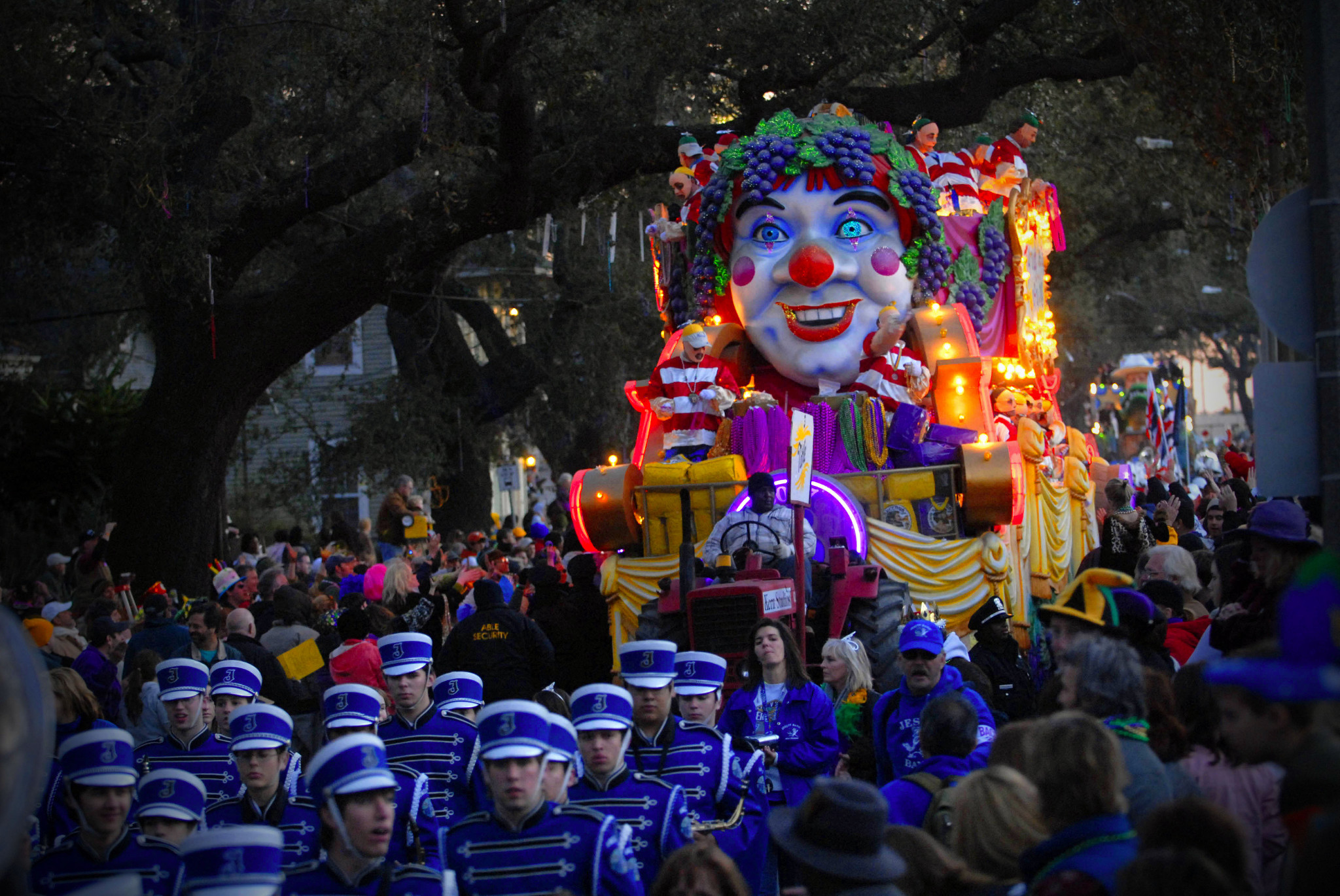 A float and marching band roll down St. Charles Avenue during the Bacchus parade. (Photo: Cheryl Gerber)