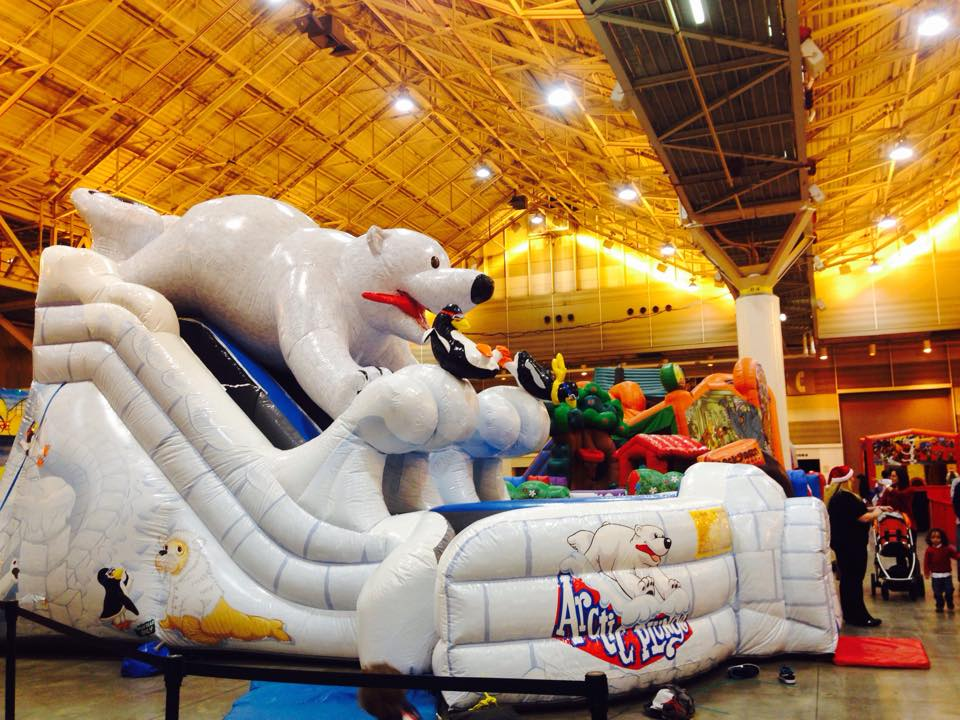 Doesn't get more kid-friendly than a huge inflatable slide. (Photo via NOLA Christmasfest on Facebook)