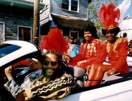 Ernie and Antoinette K-Doe ride as King and Queen in a parade to celebrate 280 years of music in New Orleans.     Photo by Pat Jolly