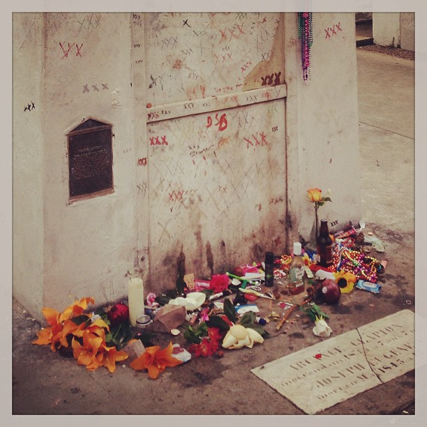 """Offerings at the tomb of """"Voodoo Queen"""" Marie Laveau. Photo courtesy of @pollywoggs on Instagram."""